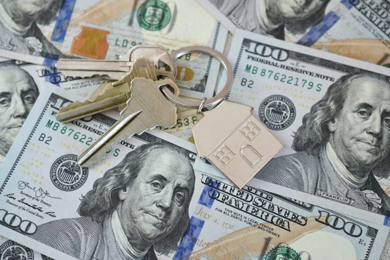 Housing Market Concept - House Keys On Money Currency, Real Estate, Home For Sale, Equity Buy Sell
